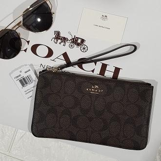 4c69cfd976ed Authentic Coach Wristlet in Signature Coated Canvas F58695 - Brown