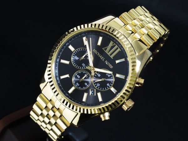 076ac19237a0 A textural topring adds eye-catching appeal to the gold-tone stainless  steel Michael Kors Lexington chronograph watch.